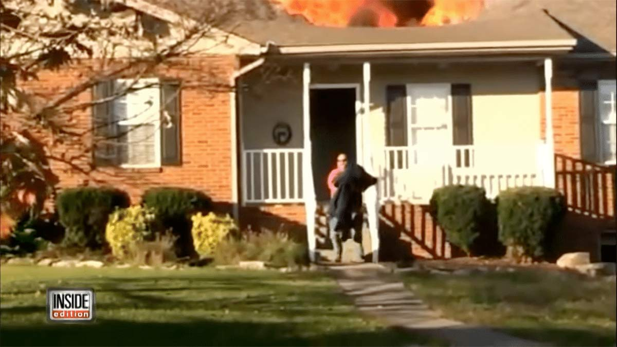 Firefighter saves dog from a burning house