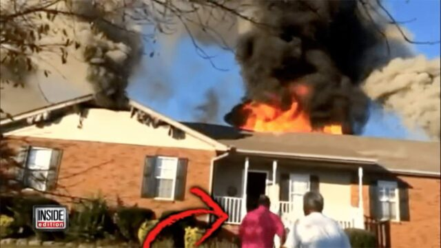 Man driving by a burning house rescues a dog from the fire