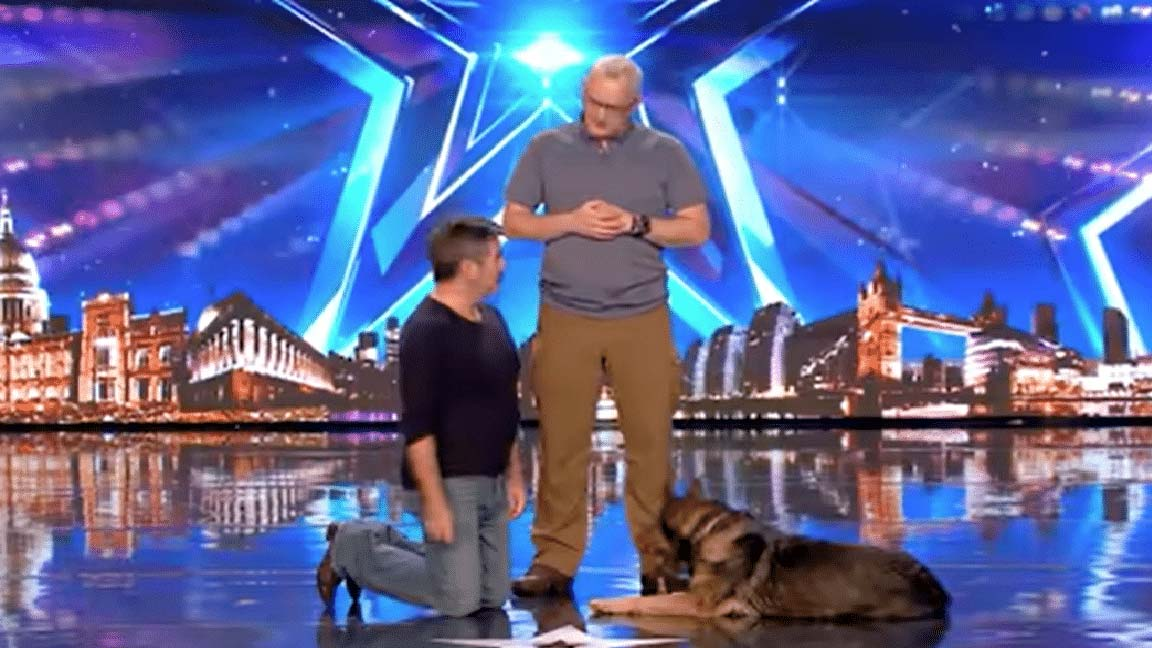This well trained police dog performs a magic act on TV